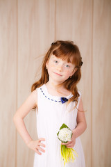 beautiful red-haired girl with snowdrops