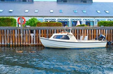 A motorboat near quaysidenear in Copenhagen, Denmark.