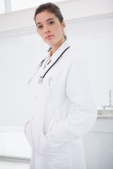 Concentrated doctor standing with stethoscope