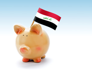 Piggy bank with national flag of Iraq
