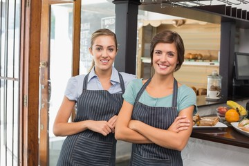 Pretty waitresses smiling at camera