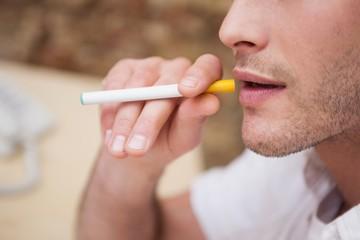 Businessman smoking an electronic cigarette
