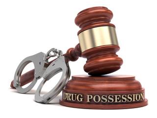 Drug Possession text on sound block & gavel