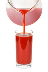 Glass of tomato juice on white background