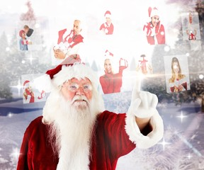 Composite image of santa pointing to christmas people collage