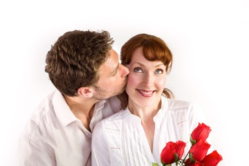 Woman getting roses from man