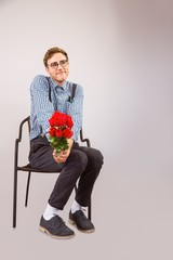 Geeky hipster holding a bunch of roses