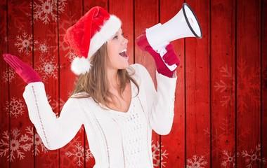 Composite image of festive blonde shouting through megaphone