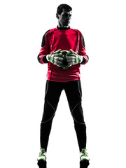caucasian soccer player goalkeeper man  holding ball silhouette