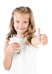 Smiling little girl with glass of milk and finger up