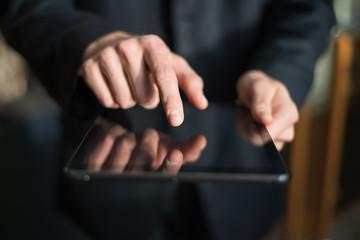 man holding digital tablet, closeup