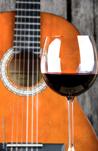 Wine and Guitar on a wooden table vintage retro photo Poster