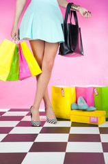 Young trendy woman wearing high heels with shopping bags