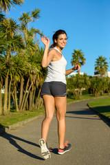 Female athlete running and waving