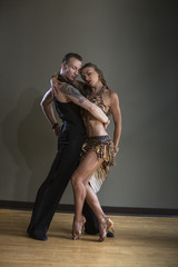 A man and woman dancing together in a dance studio.