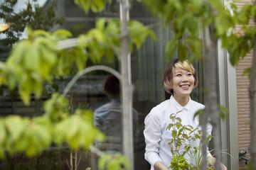 A woman standing in her garden.