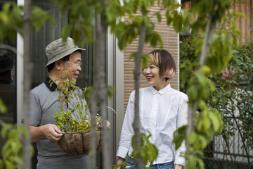 A man and a woman standing in their garden.