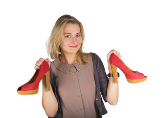 Young attractive woman holding red shoes