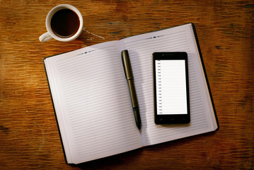 Mobile phone on an open diary or journal