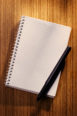 Blank notebook and pencil on a desk