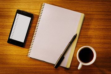 Organizer and Notebook with Cup of Coffee on Desk