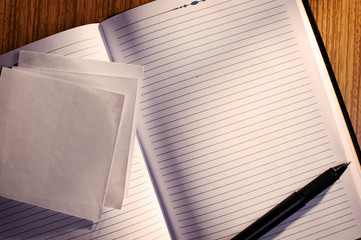 Lined Notebook with Pen on Desk