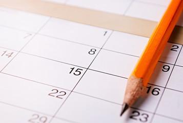 Pencil lying on a calendar