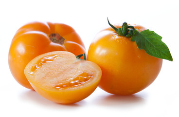 Yellow  persimmon tomatoes  isolated on white.