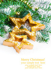 Golden Christmas stars with pine branch and snow, with free spac