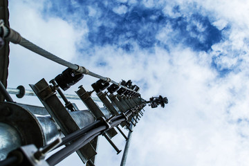 High mast metal structure telecommunication on tower with blue s