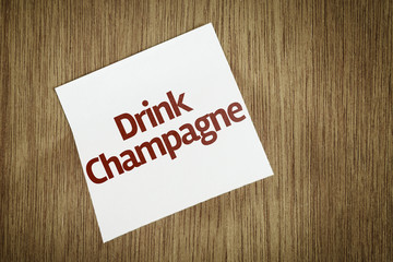 Drink Champagne on Paper Note with texture background