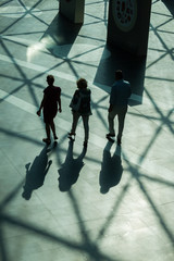 Silhouettes and shadows of people walking