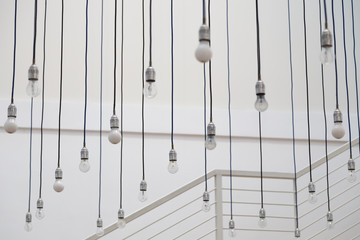 Hanging light bulbs on blurred background