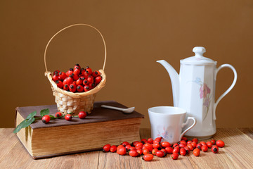 Fresh rose hips and teapot