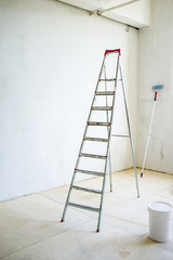 repair of a new apartment, painting the walls with stepladder