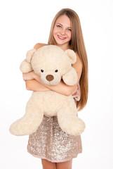 attractive positive blonde hugging a teddy bear