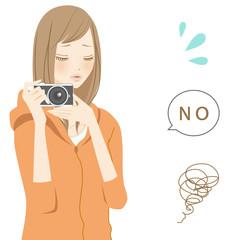 ネガティブパーツ カメラを構える困る女性