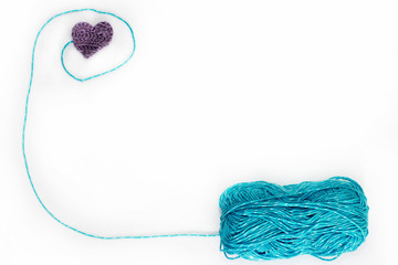 blue skein with crochet heart