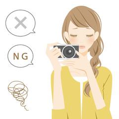 ネガティブパーツ カメラを構え困る女性