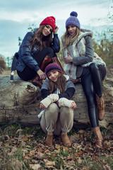 Happy tree women wearing a woolly hats