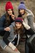 Happy tree girls wearing a woolly hats