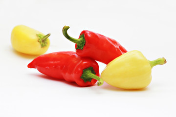 Red and yellow paprika  isolated on white background