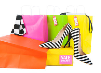 Sale shopping concept clothes in colorful bags