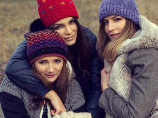 Portrait of happy women in woolly hats