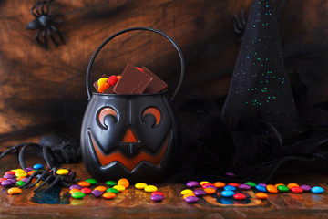Sweets chocolate candy for Halloween, witch hat, spider, web