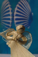 straw beautiful angel on the blue background
