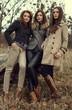 Three women posing outoor