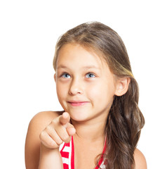 funny little girl points a finger in front of a white background