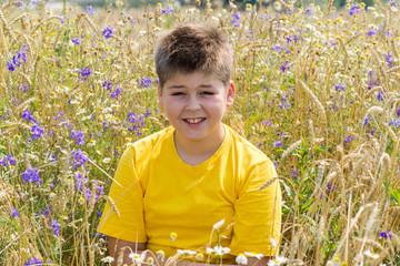 Boy in a field with flowers