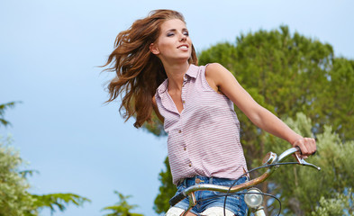Vacation in Tuscany. Girl on bike